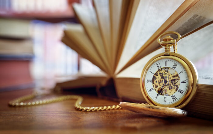 Pocket watch and books in library or study