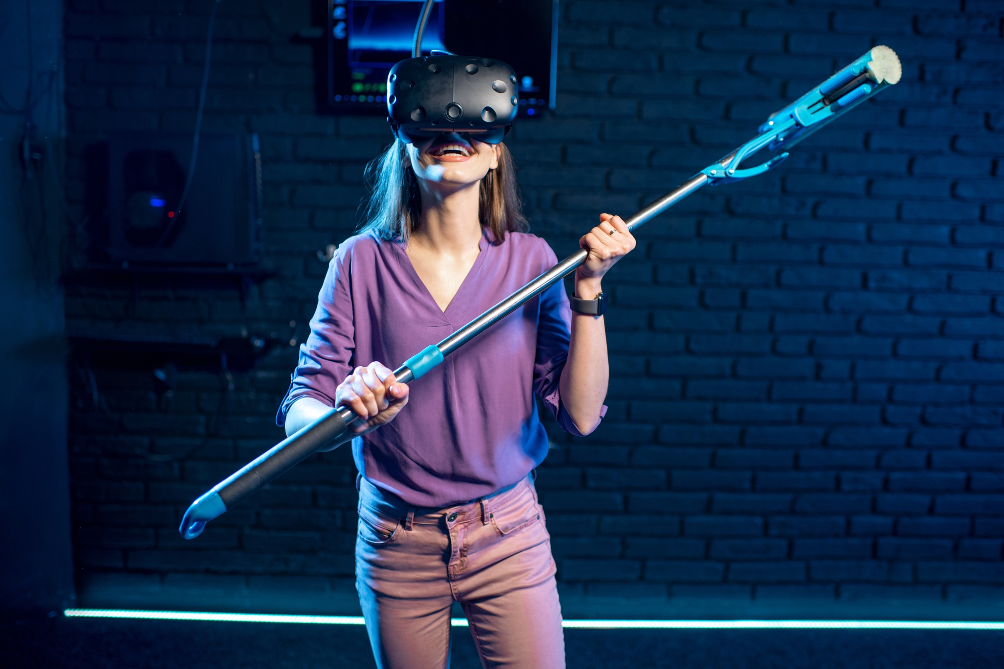 Woman in virtual reality imagines herself as a housewife standing with washing swab indoors